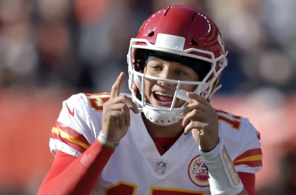 FILE - In this Sunday, Nov. 4, 2018, file photo, Kansas City Chiefs quarterback Patrick Mahomes (15) gives instructions to players during the first half of an NFL football game against the Cleveland Browns in Cleveland. The This honor of MVP has gone to a quarterback the last five seasons and 10 of 11. Halfway through the season, Mahomes is a candidate for MVP. (AP Photo/David Richard, File)