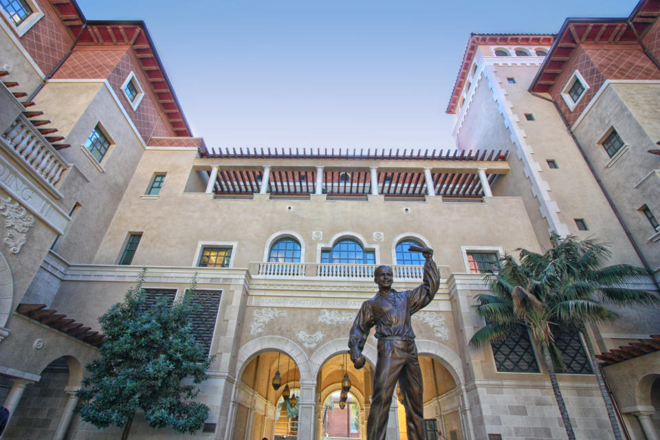 University of Southern California's school of cinematic Art. Statue of a swashbuckling Douglas Fairbanks greets as you enter. Courtyard of film school with Steven Spielberg and George Lucas buildings on either side. Los Angeles, California.