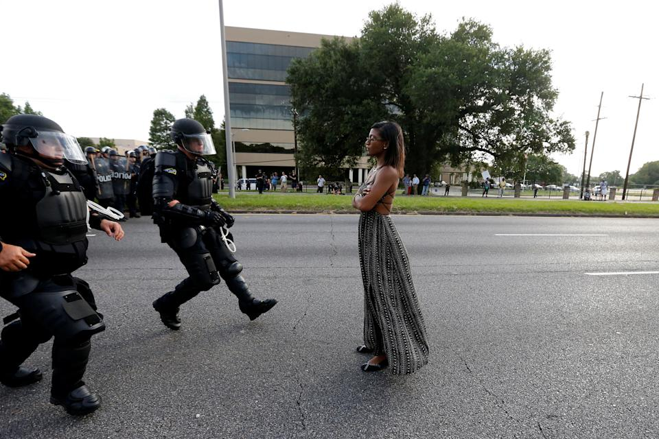 "Protestor Ieshia Evans is approached by law enforcement near the headquarters of the Baton Rouge Police Department in Baton Rouge, Louisiana, U.S. July 9, 2016. REUTERS/Jonathan Bachman SEARCH ""#BLACK LIVES MATTER"" FOR THIS STORY. SEARCH ""THE WIDER IMAGE"" FOR ALL STORIES."