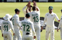 South Africa celebrate the wicket of Sri Lanka's Dinesh Chandimal on day one of the first cricket test match between South Africa and Sri Lanka at Super Sport Park Stadium in Pretoria, South Africa, Saturday, Dec. 26, 2020.(AP Photo/Catherine Kotze)