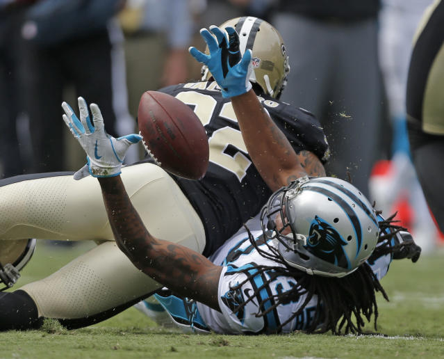 <p>Carolina Panthers' Kelvin Benjamin (13) reaches for the ball as New Orleans Saints' Kenny Vaccaro (32) defends in the first half of an NFL football game in Charlotte, N.C., Sunday, Sept. 24, 2017. (AP Photo/Bob Leverone) </p>