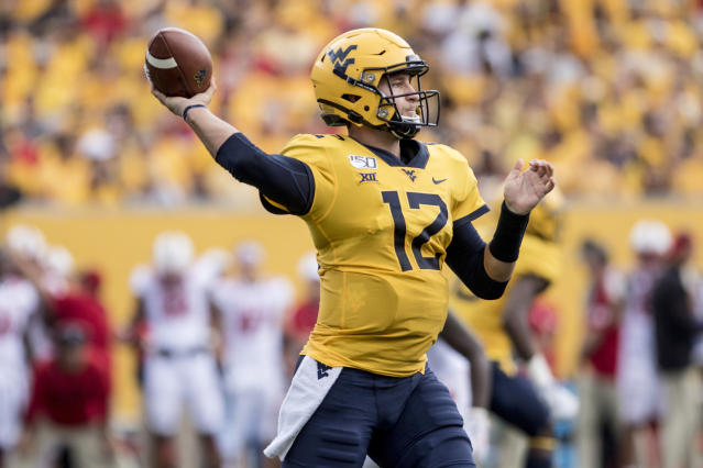 West Virginia quarterback Austin Kendall (12) attempts a pass during the first half of an NCAA college football game against North Carolina State Saturday, Sept. 14, 2019, in Morgantown, W.Va. (AP Photo/Raymond Thompson)