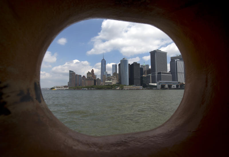 Lower Manhattan is visible through a closed chock on the Staten Island Ferry, in New York's Upper Bay, Tuesday, June 11, 2013. Giant removable floodwalls would be erected around lower Manhattan, and levees, gates and other defenses would be built elsewhere around the city under a nearly $20 billion plan proposed Tuesday by Mayor Michael Bloomberg to protect New York from storms and the effects of global warming. (AP Photo/Richard Drew)