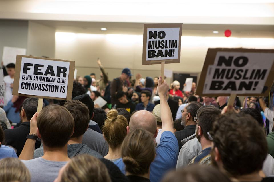 Protesters gather to denounce President Donald Trump's executive order that bans certain immigration, at Dallas-Fort Worth International Airport on January 28, 2017 in Dallas, Texas.