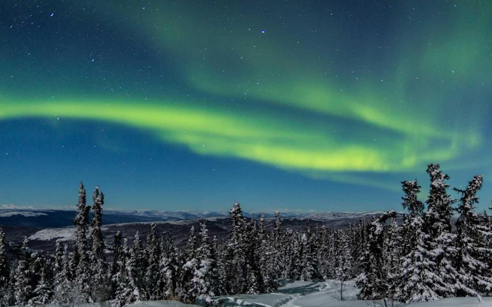 """<p>As luck would have it, Alaska will see a <a rel=""""nofollow noopener"""" href=""""https://www.timeanddate.com/eclipse/in/usa/fairbanks"""" target=""""_blank"""" data-ylk=""""slk:Total Lunar Eclipse"""" class=""""link rapid-noclick-resp"""">Total Lunar Eclipse</a> on January 31, 2018. The moon will go pink or even blood-red between 3:51 a.m. and 4:29 a.m. local time as it passes completely through the Earth's dark shadow. Your challenge: photograph an eclipsed moon surrounded by Northern Lights.</p>"""