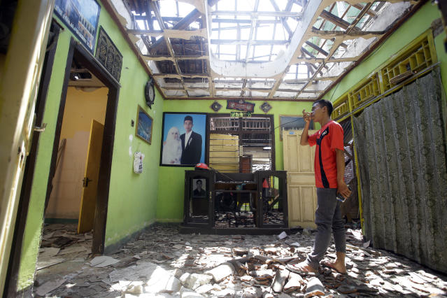 <p>A villager visits his damaged house in the Kekait village affected by Sunday's earthquake in North Lombok, Indonesia, Wednesday, Aug. 8, 2018. (Photo: Firdia Lisnawati/AP) </p>