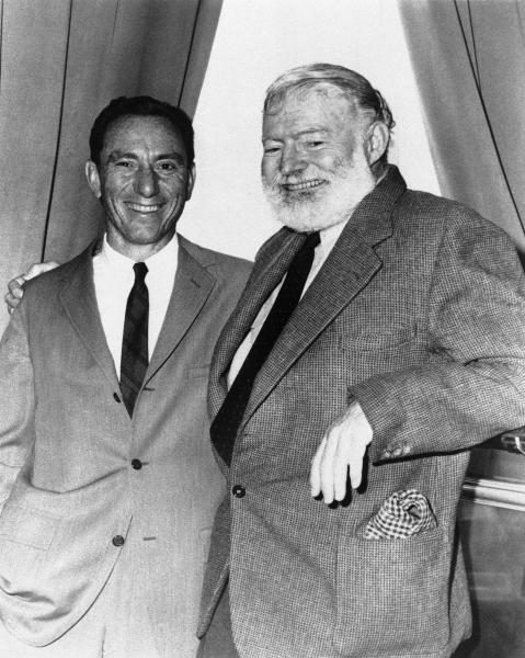 """FILE - In this undated file photo, A.E. Hotchner, left, and author Ernest Hemingway pose for a photo in Seattle. Hotchner was staging Hemingway's story """"A Short Happy Life"""" in a pre-Broadway tour in Seattle. A.E. Hotchner, a well-traveled author, playwright and gadabout whose street smarts and famous pals led to a loving, but litigated memoir of Hemingway, business adventures with Paul Newman and a book about his Depression-era childhood that became a Steven Soderbergh film, died Saturday, Feb. 15, 2020, at age 102. (AP Photo, File)"""