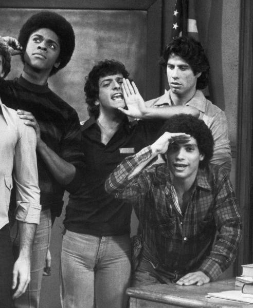 """FILE - This 1978 file photo originally from ABC shows cast members, from left, Lawrence Hilton-Jacobs as Freddy Washington, Ron Palillo as Arnold Horshack, Robert Hegyes as Juan Epstein, foreground, John Travolta, rear, as Vinnie Barbarino from the television sitcom """"Welcome Back, Kotter."""" Palillo, best known as the nerdy high schooler Arnold Horshack on """"Welcome Back, Kotter,"""" died Tuesday, Aug. 14, 2012, in Palm Beach Gardens, Fla., of an apparent heart attack. He was 63. (AP Photo/ABC, file)"""