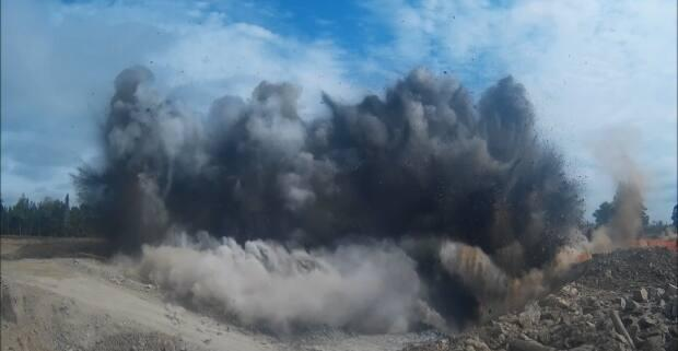Atlantic Gold wants to develop an open-pit gold mine about 30 kilometres north of Sheet Harbour, N.S. This photo shows blasting that took place when the company's Touquoy mine was being developed in Moose River, N.S.  (Submitted by Atlantic Gold Corp. - image credit)