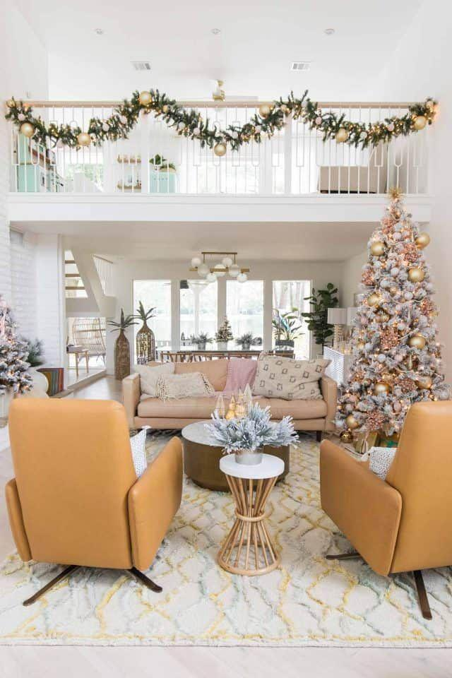 """<p>This pretty garland with pink accents proves that Christmas doesn't have to be all about red and green.</p><p><strong>See more at <a href=""""https://sugarandcloth.com/our-living-room-christmas-decorations-pink-ornaments/"""" rel=""""nofollow noopener"""" target=""""_blank"""" data-ylk=""""slk:Sugar & Cloth"""" class=""""link rapid-noclick-resp"""">Sugar & Cloth</a>.</strong></p><p><a class=""""link rapid-noclick-resp"""" href=""""https://www.amazon.com/Designer-Seamless-Christmas-Ornaments-Pieces/dp/B08H5P6TGT/ref=sr_1_2?dchild=1&keywords=pink+glass+ornaments&qid=1633170897&sr=8-2&tag=syn-yahoo-20&ascsubtag=%5Bartid%7C2164.g.37723896%5Bsrc%7Cyahoo-us"""" rel=""""nofollow noopener"""" target=""""_blank"""" data-ylk=""""slk:SHOP PINK ORNAMENTS"""">SHOP PINK ORNAMENTS</a></p>"""