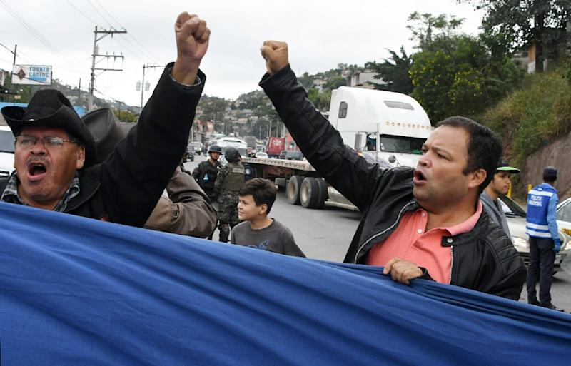 Supporters of opposition presidential candidate Salvador Nasralla hold a protest in the Honduran capital Tegucigalpa