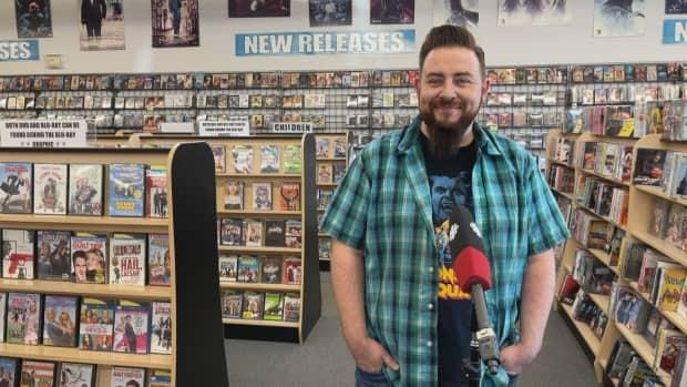 Joe French took over as owner of Movieworld just over a year ago. He credits the video store's survival to greater competition among streaming services and nostalgia. (Emily Fitzpatrick/CBC - image credit)