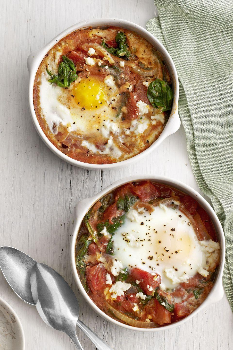 "<p>Baked eggs are super easy to pull together, so whip these up when you're in a hurry or want a more <a href=""https://www.womansday.com/weeknight-dinners/"" rel=""nofollow noopener"" target=""_blank"" data-ylk=""slk:laidback dinner"" class=""link rapid-noclick-resp"">laidback dinner</a>. </p><p><a href=""https://www.womansday.com/food-recipes/food-drinks/recipes/a39355/baked-eggs-spinach-tomato-recipe-clv0313/"" rel=""nofollow noopener"" target=""_blank"" data-ylk=""slk:Get the Baked Eggs with Spinach and Tomato recipe."" class=""link rapid-noclick-resp""><em>Get the Baked Eggs with Spinach and Tomato recipe.</em></a></p>"