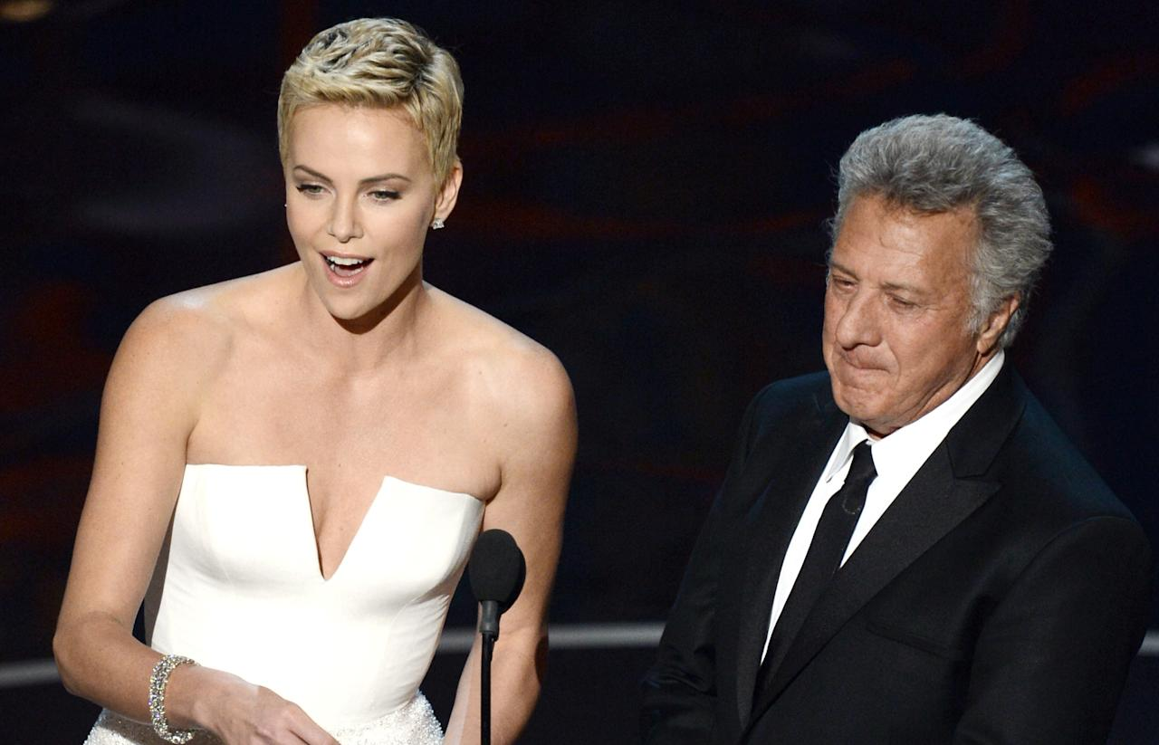 HOLLYWOOD, CA - FEBRUARY 24:  Actress Charlize Theron and actor Dustin Hoffman present onstage during the Oscars held at the Dolby Theatre on February 24, 2013 in Hollywood, California.  (Photo by Kevin Winter/Getty Images)