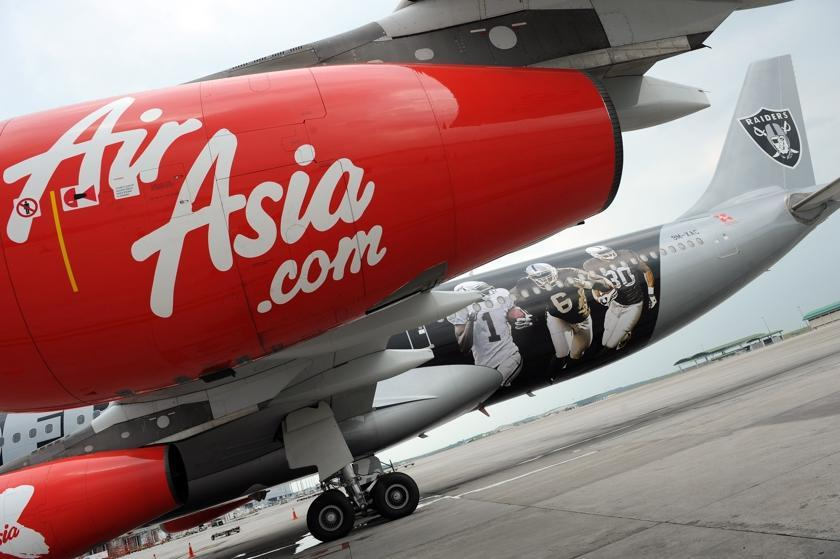 AirAsia Group Berhad's stocks up Hong Kong tycoon Stanley Choi increased his stakes in the Malaysian low-cost carrier. — AFP pic