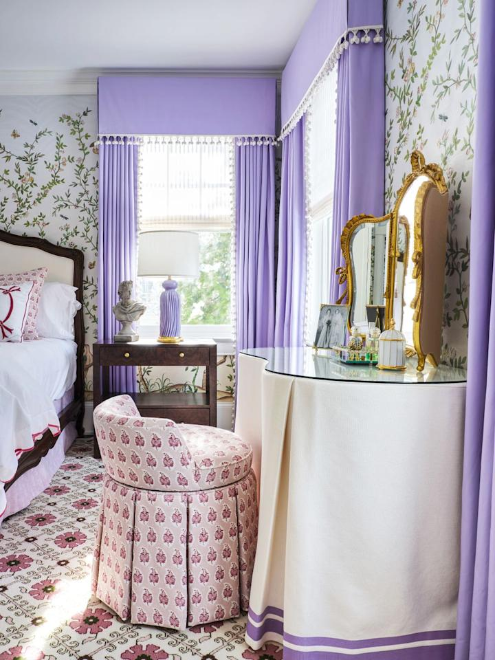 """<p>If you have room, scoot in a dressing table. In this bedroom designed by Cameron Ruppert Interiors, the purple <a href=""""https://www.housebeautiful.com/design-inspiration/g30779384/trim-passementerie-designer-details/"""" target=""""_blank"""">trim </a>on the vanity skirt reflect the drapes and table lamp, ensuring that nothing feels out of place. </p><p><em>Check out <a href=""""https://www.onekingslane.com/"""" target=""""_blank"""">Onne Kings Lane</a> for reliable bedroom staples, and <strong>shop our pick </strong>below:</em></p><p>Addie Blush Pink Vanity Stool ($375) <a class=""""body-btn-link"""" href=""""https://go.redirectingat.com?id=74968X1596630&url=https%3A%2F%2Fwww.onekingslane.com%2Fp%2F4730458-addie-vanity-stool-blush-linen.do&sref=https%3A%2F%2Fwww.housebeautiful.com%2Froom-decorating%2Fbedrooms%2Fg648%2Fbeautiful-designer-bedrooms%2F"""" target=""""_blank"""">BUY NOW</a></p>"""