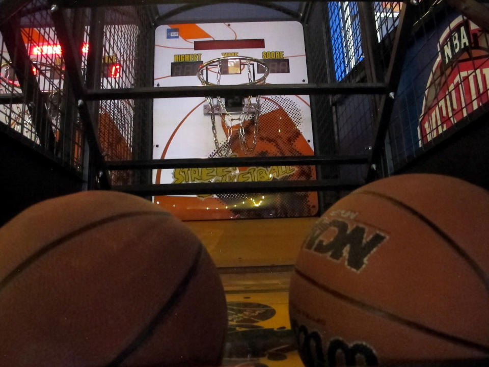 A basketball-shooting game sits inside the soon-to-open Lucky Snake arcade, Wednesday, April 21, 2021, at the former Showboat casino in Atlantic City, N.J. Philadelphia developer Bart Blatstein is spending nearly $130 million on attractions at the former Atlantic City casino including an indoor water park; a retractible domed concert hall, a beer garden and a Boardwalk sun deck to increase family entertainment options in Atlantic City. (AP Photo/Wayne Parry)