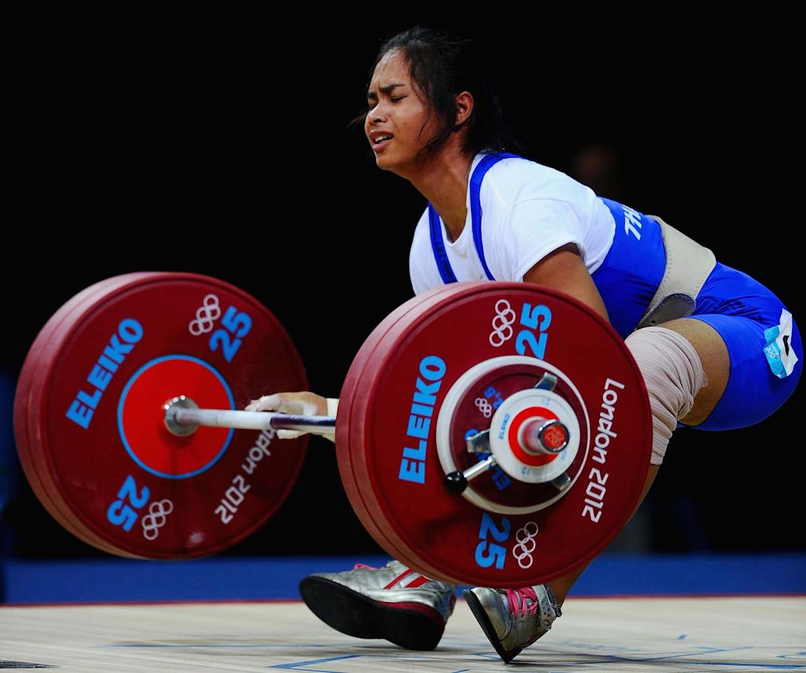 LONDON, ENGLAND - JULY 30:  Rattikan Gulnoi of Thailand falls while competing in the Women's 58kg Weightlifting on Day 3 of the London 2012 Olympic Games at ExCeL on July 30, 2012 in London, England.  (Photo by Laurence Griffiths/Getty Images)