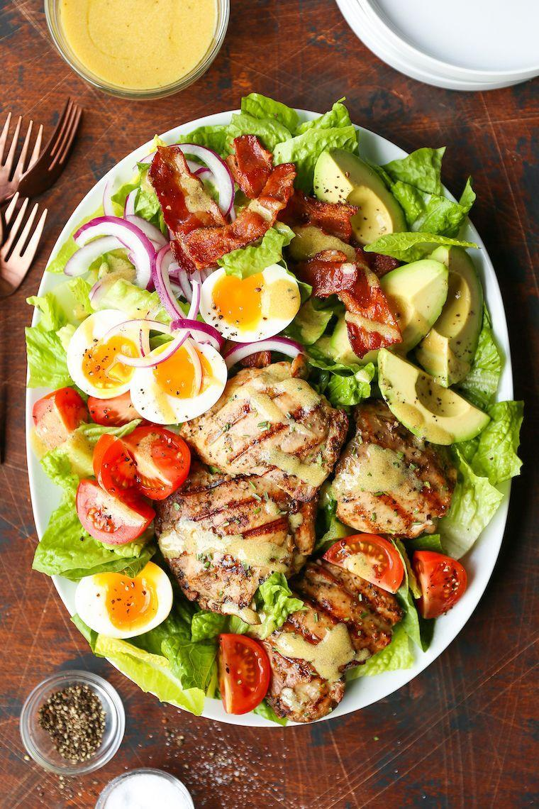 """<p>If you haven't tried grilling your chicken before throwing it in your salads, you're going to want to start. This tutorial makes it easy.</p><p><strong>Get the recipe at <a href=""""https://damndelicious.net/2019/04/29/grilled-chicken-cobb-salad/"""" rel=""""nofollow noopener"""" target=""""_blank"""" data-ylk=""""slk:Damn Delicious"""" class=""""link rapid-noclick-resp"""">Damn Delicious</a>.</strong></p><p><strong><a class=""""link rapid-noclick-resp"""" href=""""https://go.redirectingat.com?id=74968X1596630&url=https%3A%2F%2Fwww.walmart.com%2Fip%2FThe-Pioneer-Woman-Frontier-Collection-13-Teal-Slotted-Spatula%2F547532946&sref=https%3A%2F%2Fwww.thepioneerwoman.com%2Ffood-cooking%2Fmeals-menus%2Fg32188535%2Fbest-grilling-recipes%2F"""" rel=""""nofollow noopener"""" target=""""_blank"""" data-ylk=""""slk:SHOP SPATULAS"""">SHOP SPATULAS</a><br></strong></p>"""