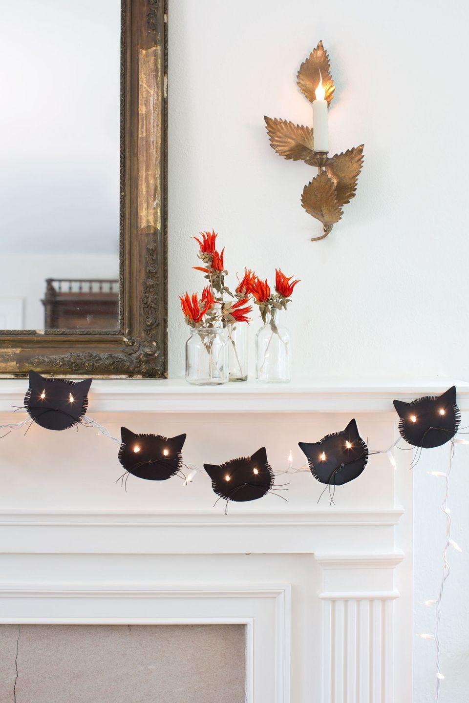 "<p>Decorate your home for fall by adding flair, like a cute Halloween garland, to your mantel. </p><p><strong><a href=""https://www.countryliving.com/home-design/decorating-ideas/g1936/halloween-mantel-ideas/"" rel=""nofollow noopener"" target=""_blank"" data-ylk=""slk:Get the tutorial"" class=""link rapid-noclick-resp"">Get the tutorial</a>.</strong></p>"