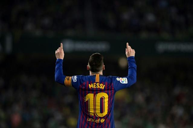 Lionel Messi celebrated the goal against Betis that is a candidate for the year's best (AFP Photo/JORGE GUERRERO)