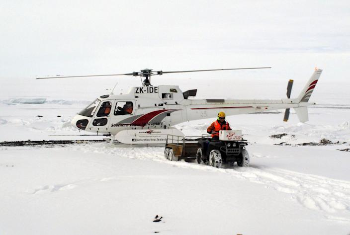 "In this Sunday, Jan. 20, 2013 photo, a sightseeing helicopter lands near New Zealand's Scott Base on Ross Island, Antarctica. Tourism is rebounding here five years after the financial crisis stifled what had been a burgeoning industry. And it's not just retirees watching penguins from the deck of a ship. Visitors are taking tours inland and even engaging in ""adventure tourism"" like skydiving and scuba diving under the ever-sunlit skies of a Southern Hemisphere summer. (AP Photo/Rod McGuirk)"