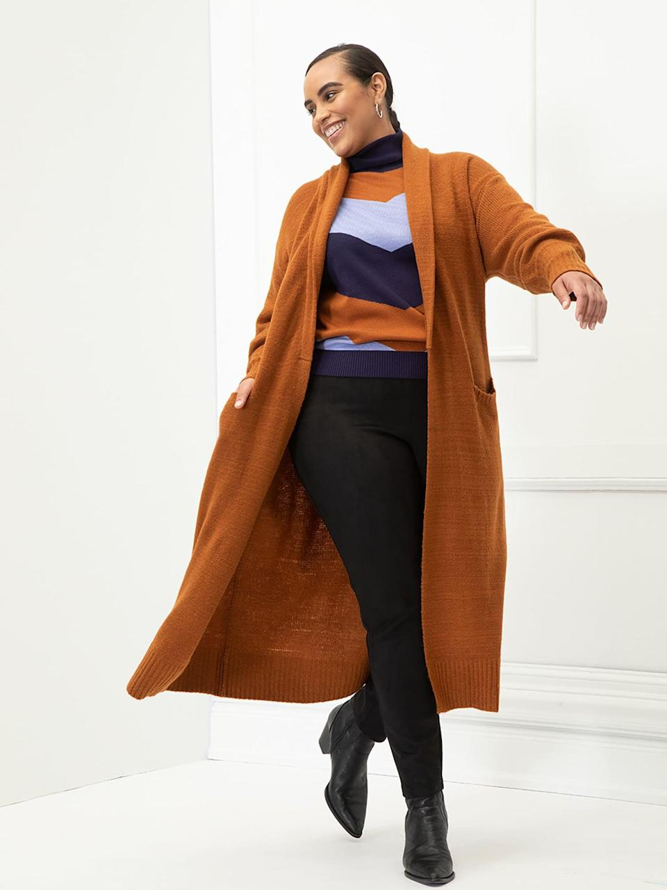 <p>You can't beat the price of this <span>ELOQUII Elements Women's Plus Size Belted Sweater Robe</span> ($40). It's insanely chic and cozy, perfect for fall activities like apple picking.</p>