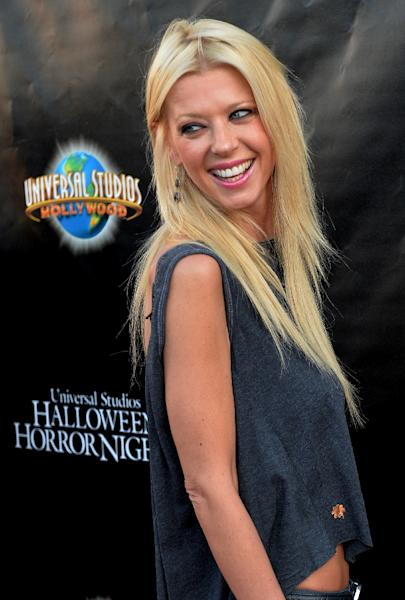 """Tara Reid, seen here in Los Angeles on September 19, 2014, has been a prize asset for """"Sharknado 2: The Second One"""" and """"Sharknado 3: Oh Hell No!"""" with her half-a-million Twitter followers (AFP Photo/Mark Ralston)"""