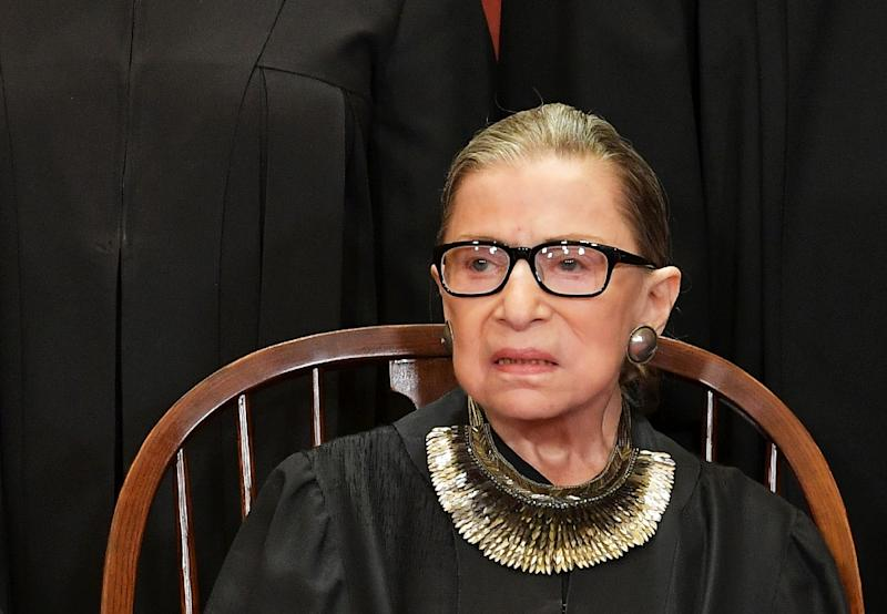 """US Supreme Court Justice Ruth Bader Ginsburg -- seen here in late November 2018 -- will continue to work from home as she recovers from surgery to remove two cancerous nodules from her lung -- a success, as there is """"no evidence of remaining disease"""""""