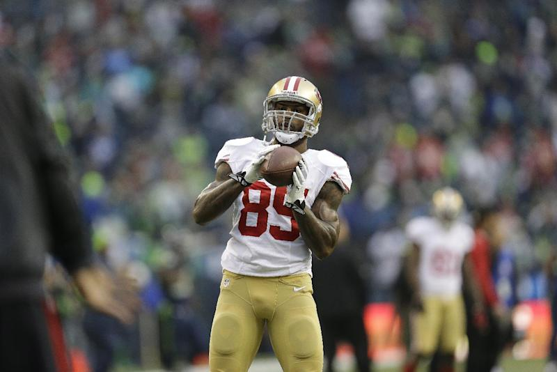 Back home from Russia, Davis regroups for football