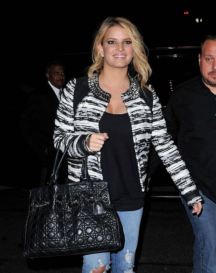 """Jessica Simpson was all smiles upon arriving in NYC on Monday. Over the weekend, she professed her love for hew new boyfriend, Eric Johnson, via Twitter: """"I met a wonderful man. Damn I'm lucky!"""" James Devaney/<a href=""""http://www.wireimage.com"""" target=""""new"""">WireImage.com</a> - September 6, 2010"""