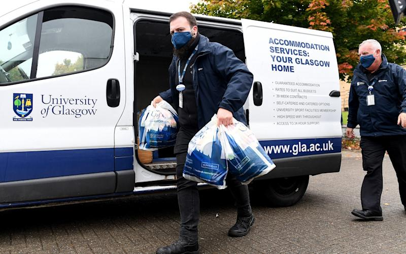 Food parcels are delivered for students at Murano Street student village on September 28 - Getty Images Europe