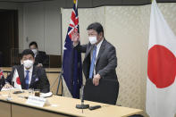 Japanese Foreign Minister Toshimitsu Motegi, right, and Defense Minister Nobuo Kishi, left, attend a video conference with Australian Foreign Minister and Minister for Women Marise Payne and Australian Defense Minister Peter Dutton at Foreign Ministry in Tokyo during their two-plus-two ministerial meeting Wednesday, June 9, 2021, in Tokyo. (AP Photo/Eugene Hoshiko, Pool)