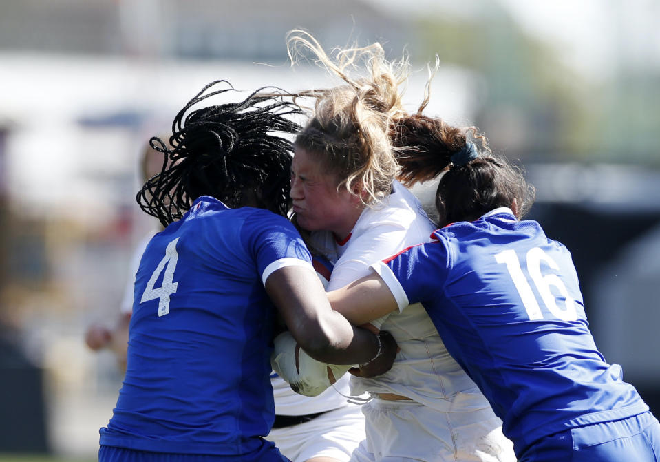 England's Poppy Cleall in action with France's Madoussou Fall and Laure Touye REUTERS/Paul Childs