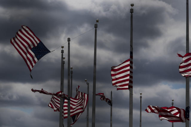 <p>Flags surrounding the Washington Monument whip in the high winds on March 2, 2018 in Washington, DC. (Photo: Carolyn Van Houten/The Washington Post via Getty Images) </p>