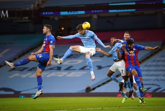 John Stones' header opens the scoring against Crystal Palace