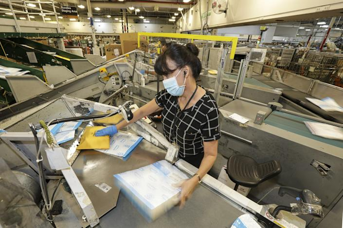 Kathleen Garcia handles mail at the City of Industry processing and distribution center.