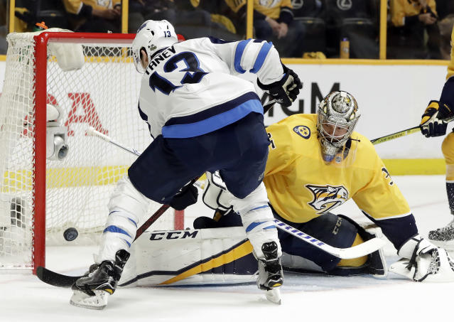 Winnipeg Jets left wing Brandon Tanev (13) scores a goal against Nashville Predators goalie Pekka Rinne (35), of Finland, during the first period in Game 1 of an NHL hockey second-round playoff series Friday, April 27, 2018, in Nashville, Tenn. (AP Photo/Mark Humphrey)