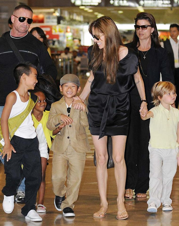 """<i>In Touch</i> has inside info from a nanny who says Brad Pitt and Angelina Jolie's house of six kids is """"rife with fighting, four-letter words, and sibling squabbles and injuries."""" According to the nanny, Jolie has created such a permissive environment that the children routinely """"watch R-rated movies"""" and 9-year-old son Maddox has even drunk wine and driven a car around the family's property. To read what an insider says about how bad it's gotten, click over to <a href=""""http://www.gossipcop.com/angelina-jolie- nanny-interview-kids-children-brad-pitt/"""" target=""""new"""">Gossip Cop</a>. Scott Larson/<a href=""""http://www.splashnewsonline.com"""" target=""""new"""">Splash News</a> - July 26, 2010"""