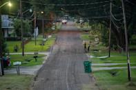 Children play in the residential streets of Reserve, Louisiana, just down the road from the Denka Performance Elastomer plant.