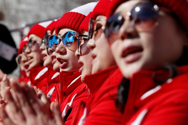Alpine Skiing – Pyeongchang 2018 Winter Olympics – Women's Slalom – Yongpyong Alpine Centre - Pyeongchang, South Korea – February 16, 2018 - North Korean cheerleaders react. REUTERS/Jorge Silva TPX IMAGES OF THE DAY