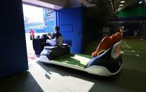 The bullpen cart is driven from the bullpen onto the field at Yokohama Baseball Stadium during the Tokyo 2020 Olympic Games