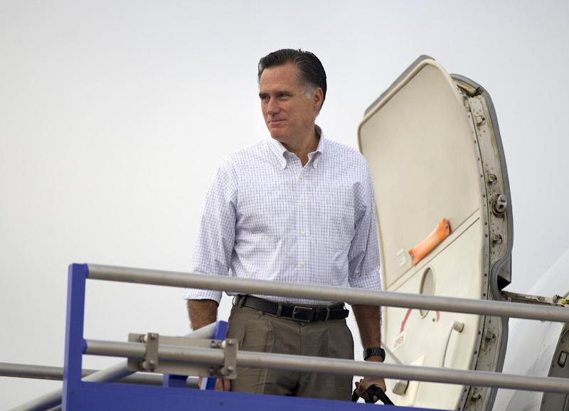 Republican presidential candidate, former Massachusetts Gov. Mitt Romney boards his plane for a campaign stop in Iowa, Wednesday, Aug. 22, 2012, in Midland, Texas. (AP Photo/Evan Vucci)