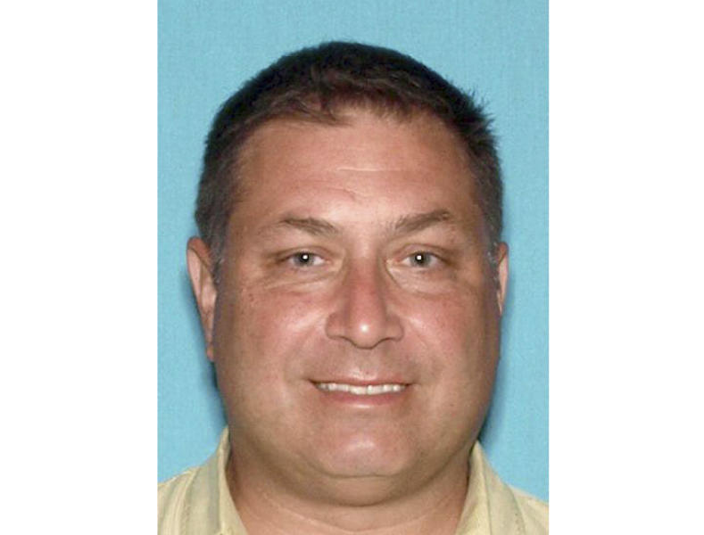 This image released by the Monmouth County Prosecutor's Office, shows Paul Caneiro, who prosecutor charged Wednesday, Nov. 21, 2018, with aggravated arson. He's accused of setting fire to his own home in Ocean Township, N.J. That fire took place early Tuesday morning before authorities responded to a deadly blaze at the Colts Neck mansion owned by Caneiro's brother Keith and Keith's wife, Jennifer.
