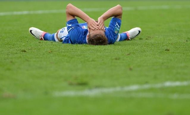 Italian midfielder Claudio Marchisio reacts on the ground during the Euro 2012 championships football match Spain vs Italy on June 10, 2012 at the Gdansk Arena. AFP PHOTO/ GIUSEPPE CACACEGIUSEPPE CACACE/AFP/GettyImages