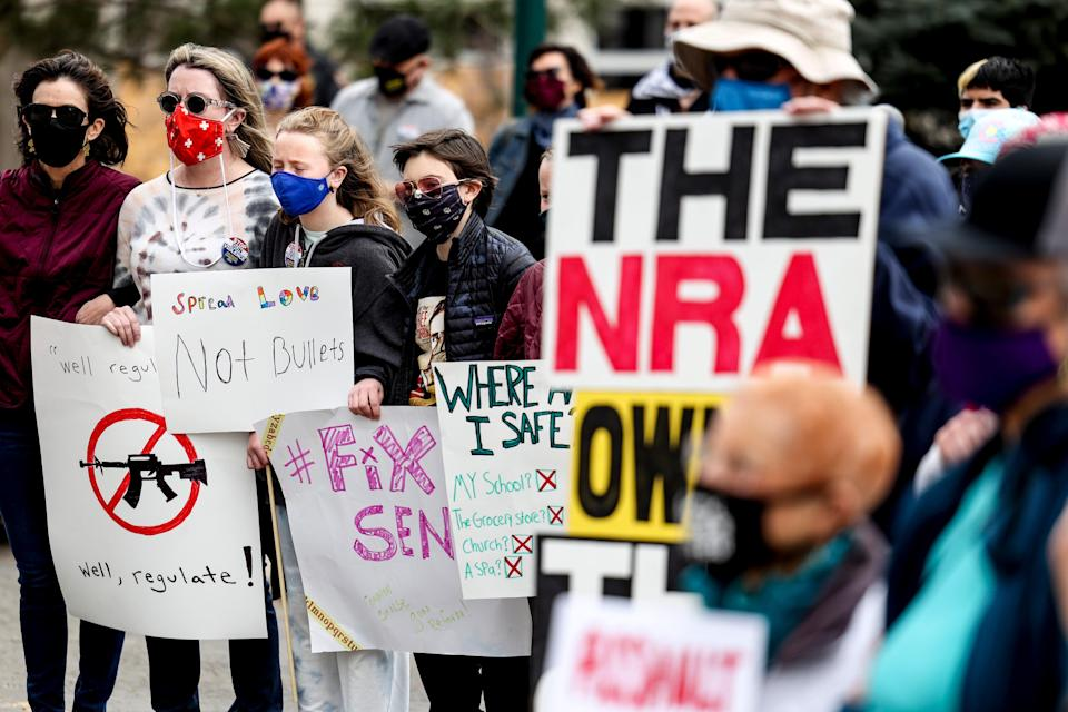 <p>File image: People link arms at a gun reform rally at the Colorado State Capitol on 28 March, 2021 in Denver, Colorado </p> (Getty Images)