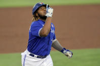 Toronto Blue Jays' Vladimir Guerrero Jr. celebrates as he rounds third base after hitting a solo home run against the Philadelphia Phillies during the first inning of a baseball game Saturday, May 15, 2021, in Dunedin, Fla. (AP Photo/Mike Carlson)