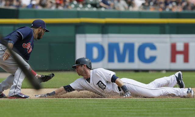 Detroit Tigers' Andrew Romine beats the throw to Cleveland Indians third baseman Mike Aviles and steals during the fifth inning of a baseball game, Sunday, July 20, 2014 in Detroit. (AP Photo/Carlos Osorio)