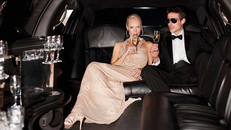 Couple drinking champagne in a limo