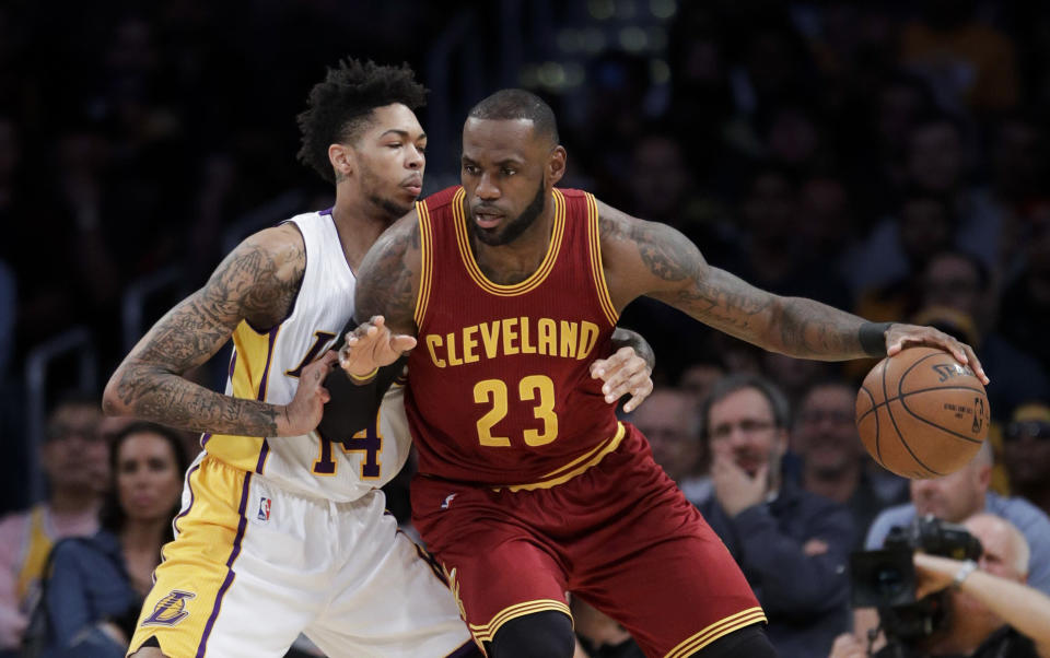 LeBron James and the Los Angeles Lakers cross paths. (AP)